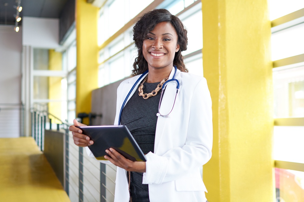 Female doctor holding tablet