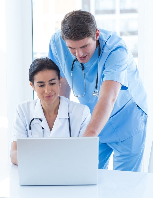 Medical professionals using laptop