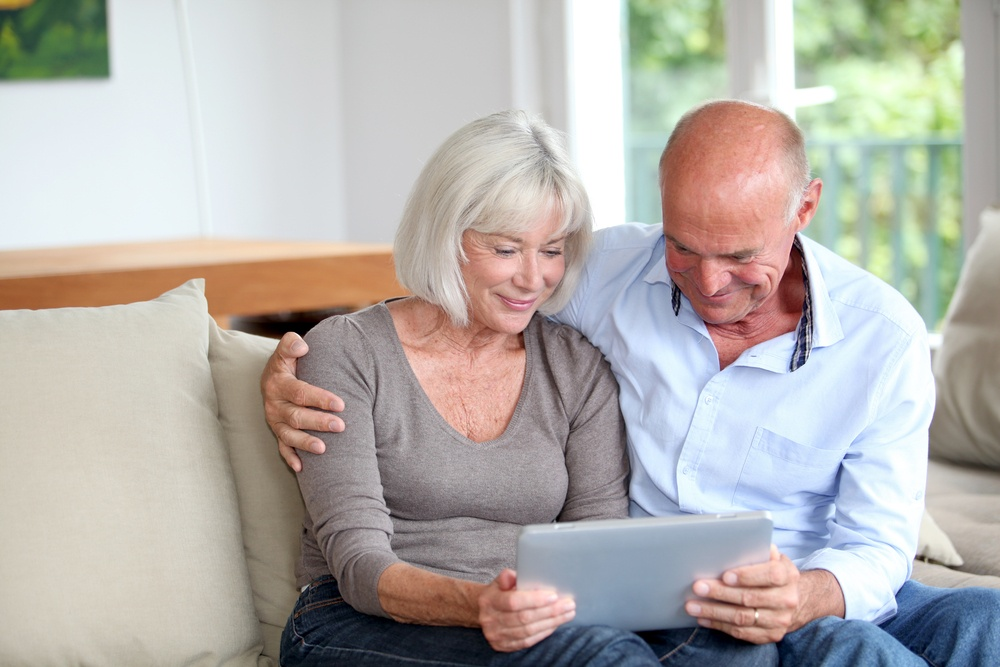 Senior couple using electronic tablet at home.jpeg