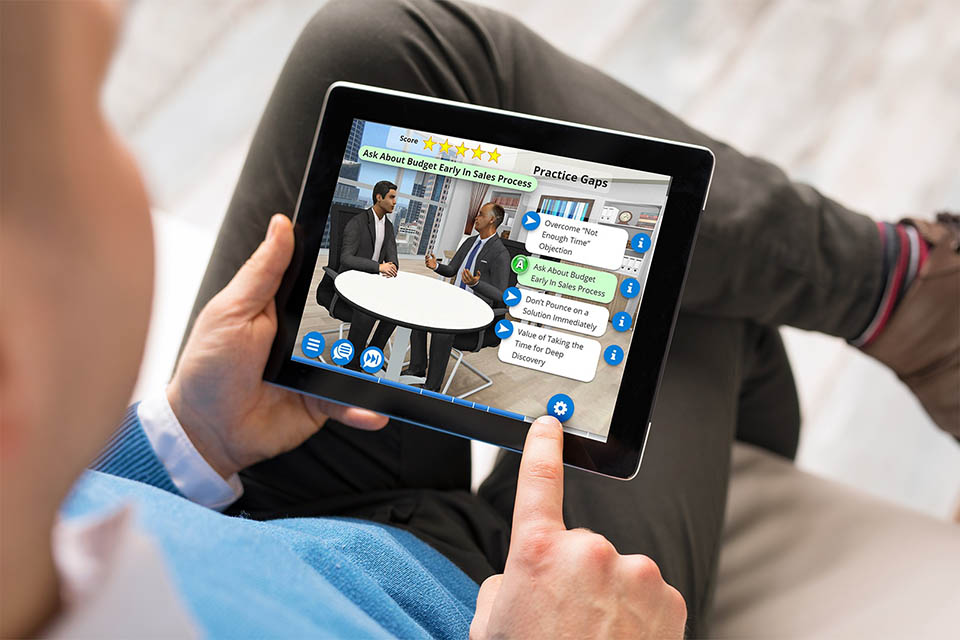Sales training simulation being used on a tablet by a professional