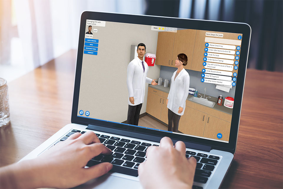 AliveSim simulation on a laptop showing a patient interaction